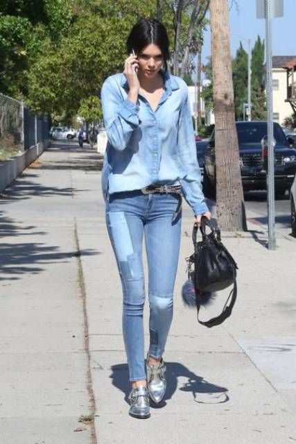 With denim shirt, black bag, jeans and silver shoes
