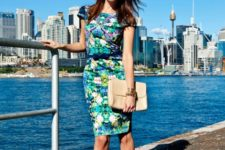 With floral dress, beige clutch and pumps