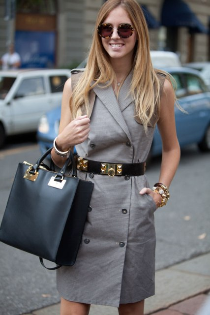 With gray sleeveless dress and bag
