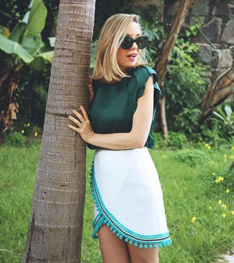 With green blouse and oversized sunglasses
