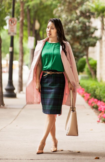 With green blouse, pale pink coat, plaid skirt, beige tote and beige pumps