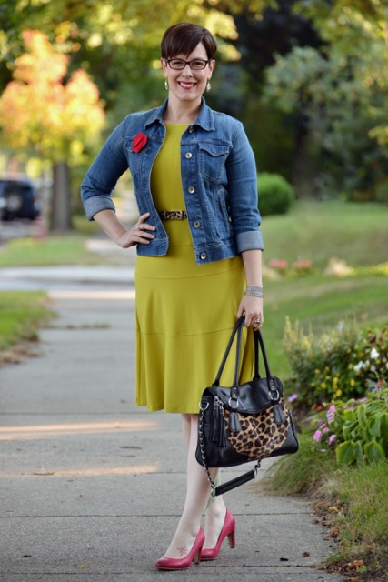 With green dress, denim jacket, printed bag and red shoes