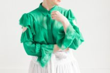 With green ruffled blouse