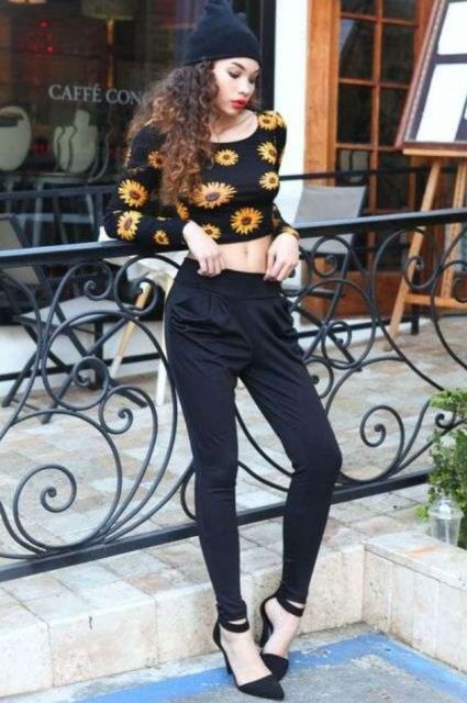 With hat, black pants and black heeled shoes