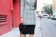 With knee-length skirt, pumps and mini bag