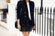With leather mini skirt, white sneakers and chain strap bag