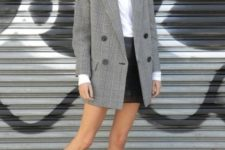 With leather skirt, ankle boots and white shirt