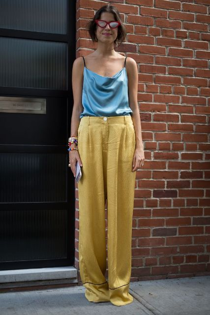 With light blue top, sunglasses and shoes