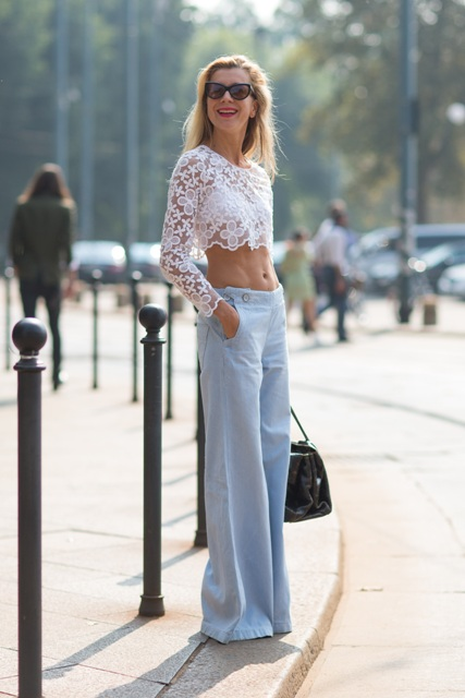 With light blue wide leg pants and black bag