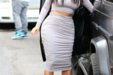 With light gray midi skirt and high heels