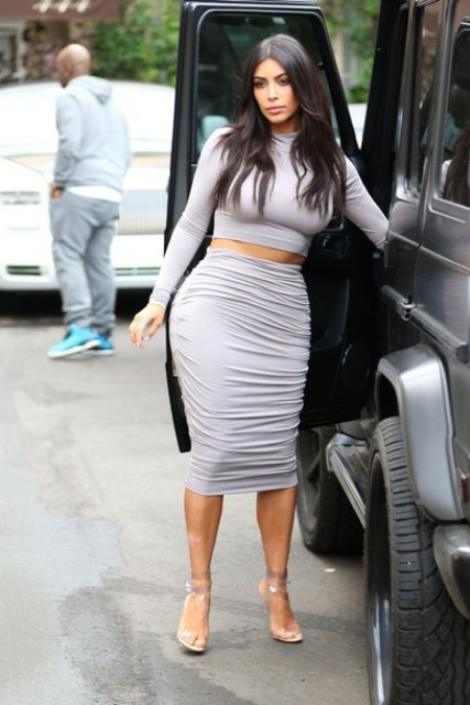 With light gray midi skirt and high heels