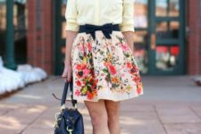 With light yellow blouse, floral skirt, navy blue bag and leopard pumps