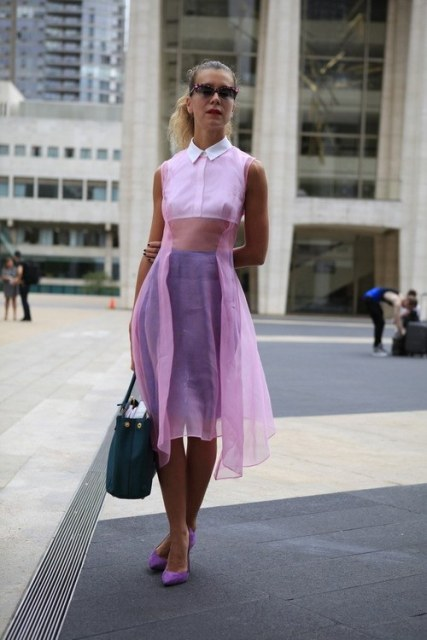 With lilac pumps and leather bag