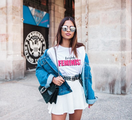 With long t shirt, denim jacket and chain strap bag
