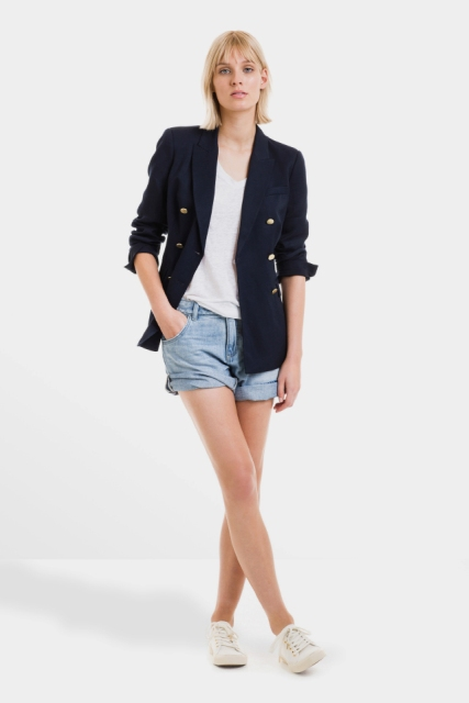 With loose shirt, denim shorts and white sneakers