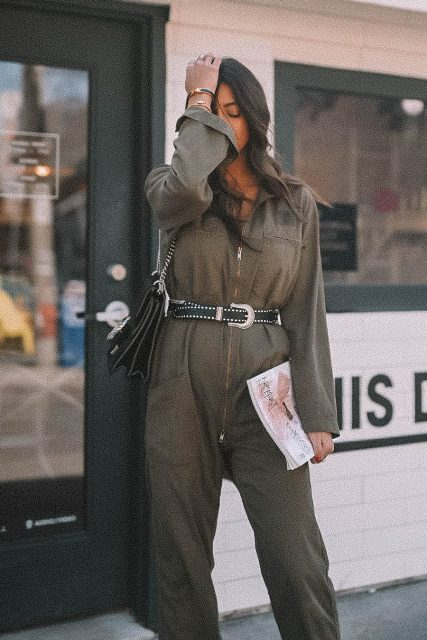 With olive green jumpsuit and bag