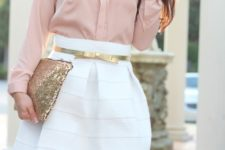 With pale pink blouse, white mini skirt and glitter clutch