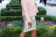 With pale pink jacket and beige pumps