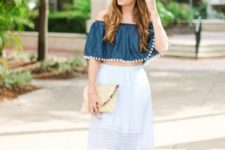 With pom pom clutch, ankle strap shoes and white pencil skirt