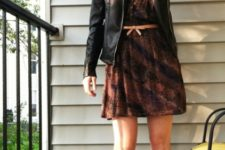 With printed dress, black leather jacket and beige flats