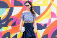 With printed off the shoulder top, belt, high heels and white bag