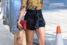 With printed shirt, sunglasses, marsala clutch and printed lace up shoes