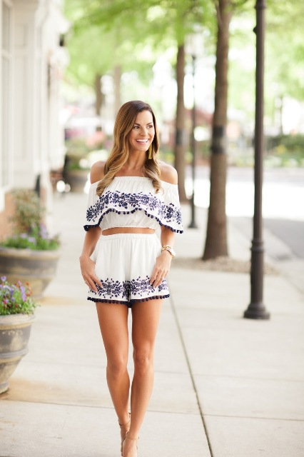 With printed shorts and high heels