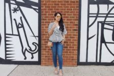 With skinny jeans, beige small bag and beige sandals