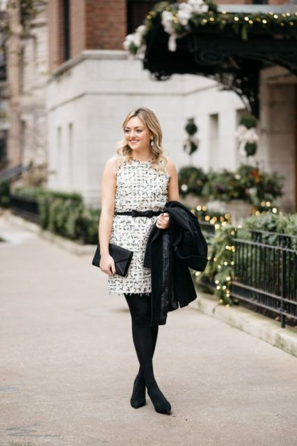 With sleeveless dress, black clutch, black jacket, tights and pumps