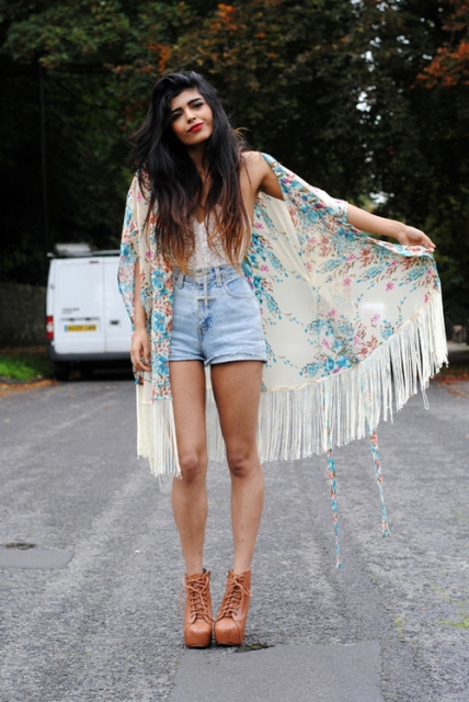 With sleeveless top, denim shorts and brown platform boots