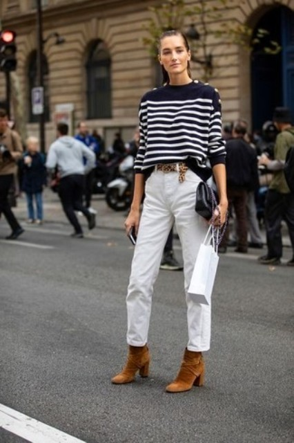 With striped loose sweatshirt, black clutch, white pants and boots