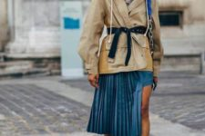 With striped shirt, beige jacket, belt, beige boots and bag
