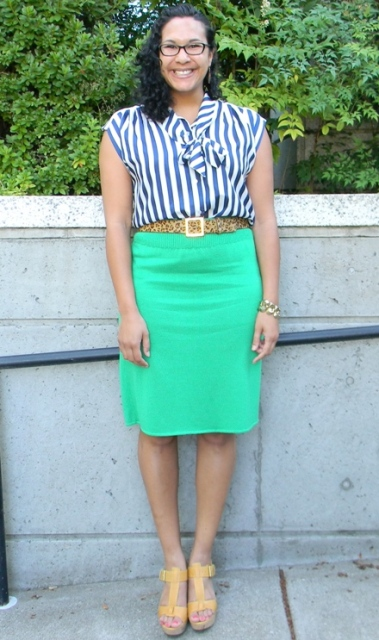 With striped shirt, green pencil skirt and yellow shoes