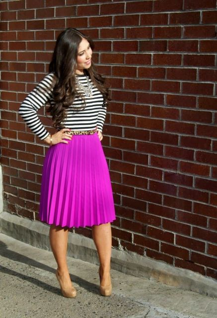 With striped shirt, pink pleated skirt and beige shoes
