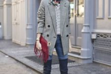 With striped shirt, scarf, fringe clutch, skinny jeans and over the knee boots