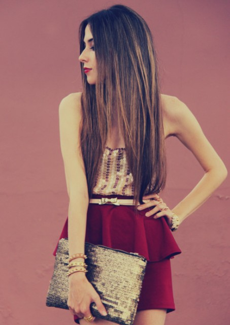 With top, marsala skirt and glitter clutch
