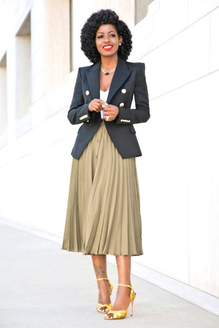 With top, pleated midi skirt and yellow shoes