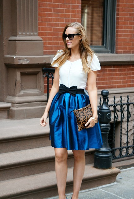 With white blouse, blue skirt and leopard clutch