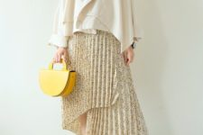 With white blouse, white cardigan, yellow bag and mules