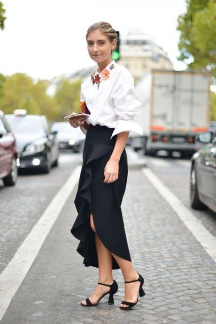 With white button down shirt, ankle strap shoes and clutch