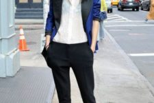 With white button down shirt, black crop trousers and ankle boots