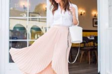 With white button down shirt, white bag and pom pom shoes