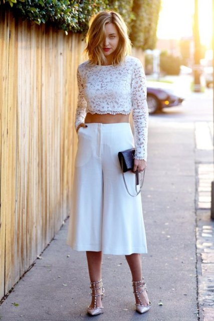 An all white summer look with white culottes, black clutch and embellished shoes