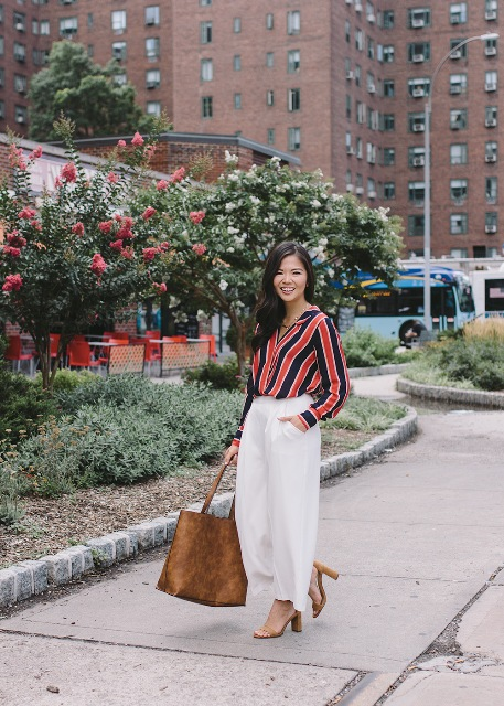 With white culottes, brown tote bag and heels
