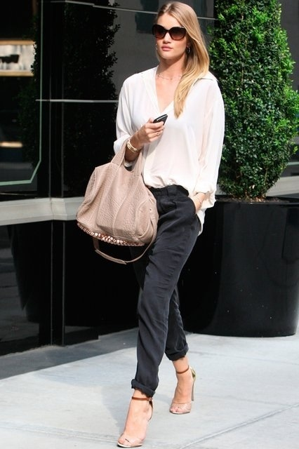 With white loose shirt, beige bag and high heels