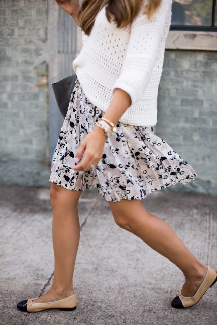 With white loose sweater, two colored flats and bag