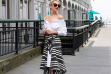With white off the shoulder blouse, sunglasses and lace up sandals