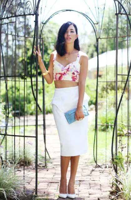 With white pencil skirt, blue clutch and white pumps
