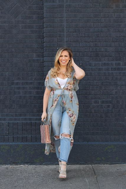 With white shirt, distressed jeans, gray shoes and embellished bag