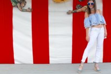 With white skinny pants, light blue sandals and white bag